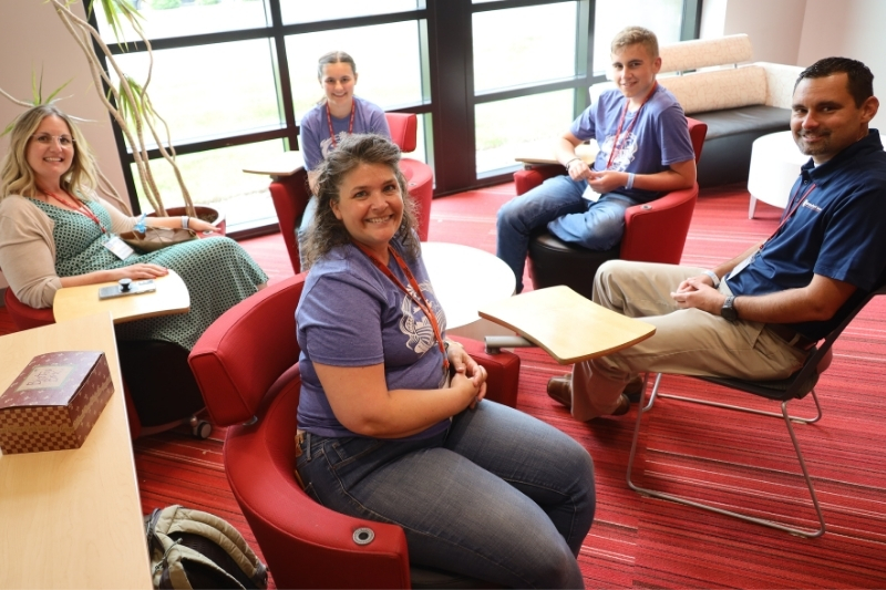 Amber with a group of volunteers at the Homeschool Iowa Conference: Supporting Your Homeschool Journey